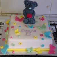 Me To You Bear / Tatty Teddy raspberry flavoured madeira sponge with raspberry jam. covered in fondant with a fondant bear and fondant accents