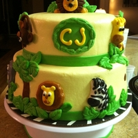 Safari Theme Baby Shower Buttercream covered cake with fondant accents. Made this one for a friend's babyshower. I loved it!