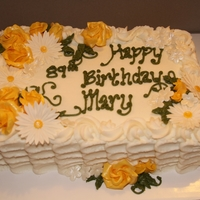 Birthday Cake 2-layer 9x13 with gumpaste flowers. Cake is lemon and frosted in lemon buttercream.