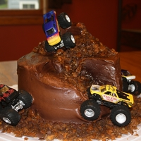 Monster Trucks Cake is peanut butter with chocolate trufle filling and chocolate cream cheese frosting.