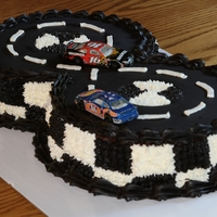 Race Car Track My son wanted a race car track cake for his 8th birthday... thanks to all of the Cake Central ideas, this is what transpired! :)