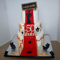 Red Carpet-Themed 50Th Birthday Cake WASC cake with strawberry SMBC, and red velvet cake with vanilla SMBC. Working spotlights in the front. All edible decorations made from...