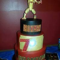 Iron Man 3 Birthday Cake Iron Man birthday cake for my nephew. The design was inspired by Cinderella Cakes. All vanilla cake marbled in red & gold Iron Man...