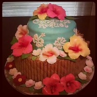 Hawaiian Luau Flowers are made from gumpaste, top tier covered in MMF with handcarved hibscus flowers. Bottom tier is surrounded by cookies.