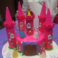 "Disney Princess Castle 8"" cake covered in MMF. Princesses are toy figurines from the dollar store, the towers are paper towel tubes covered in MMF and the..."