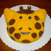 Giraffe This was my first attempt at cake decorating for my little boy's first birthday party. It is made using the Animal Crackers Pan.