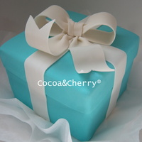 Tiffany Box Cake Chocolate cake filled with raspberry and chocolate.