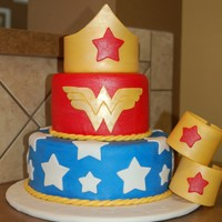 Wonderwoman Fondant Cuffs and Crown. Birthday cake for a lucky 4 year old.
