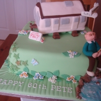 Caravan Man 60th birthday cake for a man who loves his caravan and fishing. The caravan is modelled on his own van. Vanilla sponge cake filled with...