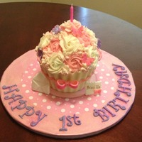 Giant Cupcake   Smash cake for a little girl's 1st Birthday. Cupcake liner is white chocolate.