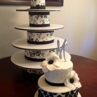 "Diy Cupcake Tower/ Black & White Wedding Cake  My first wedding cake! The bride, who is also a friend asked for ""just cupcakes"" but I was too excited to do an actual wedding..."