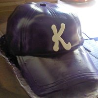 Baseball Cap Cake Vanilla cake covered in fondant and airbrushed