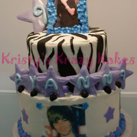 Justin Bieber two tier justin bieber iced in butter cream with fondant and gumpaste decor. all photos are edible except the frame