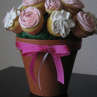 Flower Pot My first cupcake bouquet. Made this for a friend's birthday. Thank goodness they stayed in place while I transported it!