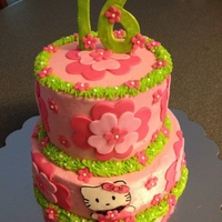 Hello Kitty Cake Butter cream 2 tier with fondant decorations and silver candies