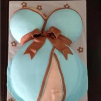 Blue Dress Pregnancy Belly With Baby Foot Imprint Fondant covered pregnancy belly with baby foot imprint cake
