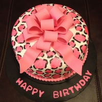 Leopard Cake Fondant covered with hand painted leopard spots with fondant bow
