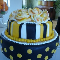 Yellow Roses On Black And Yellow Decorated Cake