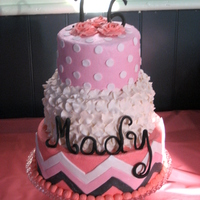 Mady's Sweet 16  Birthday cake for my niece's sweet sixteen. Chocolate and vanilla cakes covered in buttercream with fondant accents. This was my first...