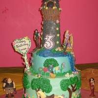 Rapunzel Tower Cake  Rapunzel cake for Reese turning 3. Bottom tier was vanilla done in rainbow colors, top tier was chocolate. Cakes were covered in...