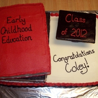 Book Grad Cake   2 book cakes on a sheet cake. cap is rice krispies covered in fondant.
