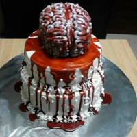 Bloody Brain Bloody brain cake! The entire cake is Iced with buttercream. The brain is red velvet (of course!). The rest is chocolate with peanut butter...