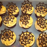 Chocolate Web Cupcake Chocolate cupcake with milk chocolate spider web on top of buttercream.