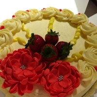 "Strawberry Cheesecake Strawberry Cheesecake covered in White Chocolate Cream Cheese Frosting. The flowers are supposed to be ""Dahlia"", it didnt turn..."