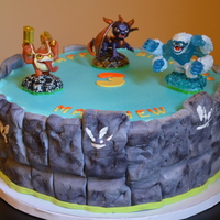 "Skylanders 3Rd Birthday Cake 10 Cake With Fondant Sides To Make The Portal   Skylander's 3rd birthday cake. 10"" cake with fondant sides to make the portal."