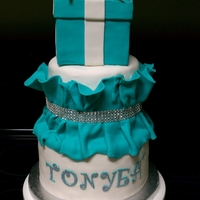 Tonyea Birthday Cake 3-tier yellow cake with ruffle fondant and diamond band