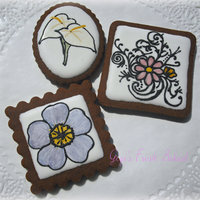 Handpainted Cookies Handpainted flowers on chocolate cookies
