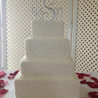 "4-Tier Square Wedding Cake   12"", 10"", 8"", 6"" tiered cake. Combination of swirls and dots."