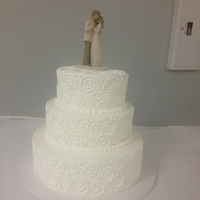 "3 Tiered Wedding Cake I used a 14"", 10"", 8"" combo with buttercream frosting. Piped on swirls."