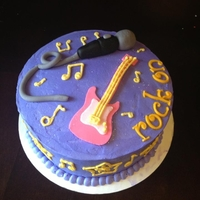 Rockstar Birthday Cake Rockstar themed cake. Fondant guitar and microphone and finished with a dusting of edible glitter.