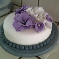 1St Fondant Cake Fondant covered cake decorated with Fantasy Flowers and a pearl border