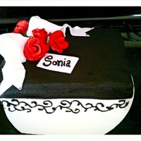 Perfect Gift Decorated using gumpaste roses and GP Bow. Royal Icing swiral design on fondant.