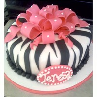 Pink Ontop And Black& White All Over   Birthday cake for an animal print lover, and finished off with a multiple loop GP bow for a perfect celebration
