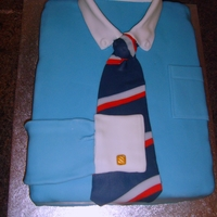 Shirt And Tie Cake My father-in-law rarely goes anywhere without being properly dressed in a shirt and tie. I made this for his 70th birthday.