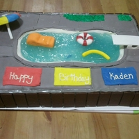 "Kids Birthday Pool Cake White cake with sprinkles, fondant and gum paste decorations. Piping gel for the water and mini chocolate bars for the ""wood fence&..."