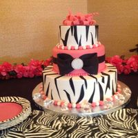 Fondant Zebra Accents On Buttercream Fondant Pink Tier With Fondant Bow Jewel Is Made Of Dragees Fondant And Sugar Crystals Pink Fond  Fondant zebra accents on buttercream. Fondant pink tier with fondant bow. Jewel is made of dragees, fondant, and sugar crystals. Pink...
