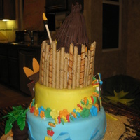 Luau Birthday Vanillla cake with cookies and cream filling. Fondant decorations and crushed cookies for sand.