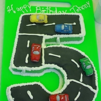 Number 5 Cake Chocolate number 5 cake with car candles