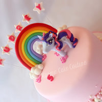 "Twighlight Sparkle A 9"" round cake with 'The Neapolitan' flavour. Gumpaste pony tutorial from Chokolate (thank you) and the clouds tutorial..."