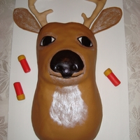 Deer Bust Birthday Cake This was a birthday cake for a co worker who is a hunter. We took some pictures first without the gunshot wound and tongue, but then added...