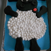 Timmy Time 1St Birthday Cake! Sheet cake with BC frosting. Head and limbs are RKT covered in fondant and belly just BC