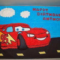 Disney's Car Cake: Lightning Mcqueen The cake board was decorated with the street and sky. The cake was made from a mold. There are fondant details and BC stars.