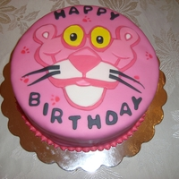 Pink Panther Birthday Cake And Cupcakes This is a Pink Panther cake and set of 24 cupcakes for my Sister-in-law's 22nd Birthday. Cake is covered in fondant with a fondant...