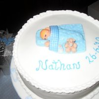 Christening Cake. Boy's Christening cake with a sleeping baby topper.