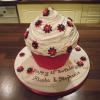 Giant Cupcake Cake. 21st birthday cupcake cake topped with marshmallow and fondant flowers.