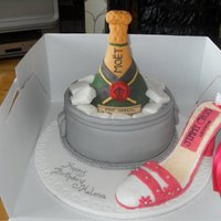 Champagne And Shoe Cake. Champagne in an ice bucket cake with a gumpaste shoe.
